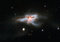NGC 6240 offers a rare, nearby glimpse of a cosmic catastrophe in its