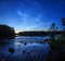 Sunlight ripples through a dark sky on this Swedish summer midnight