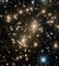 Some 4 billion light-years away, massive galaxy cluster Abell 370