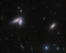 Spiral galaxy pair NGC 4567 and NGC 4568 share