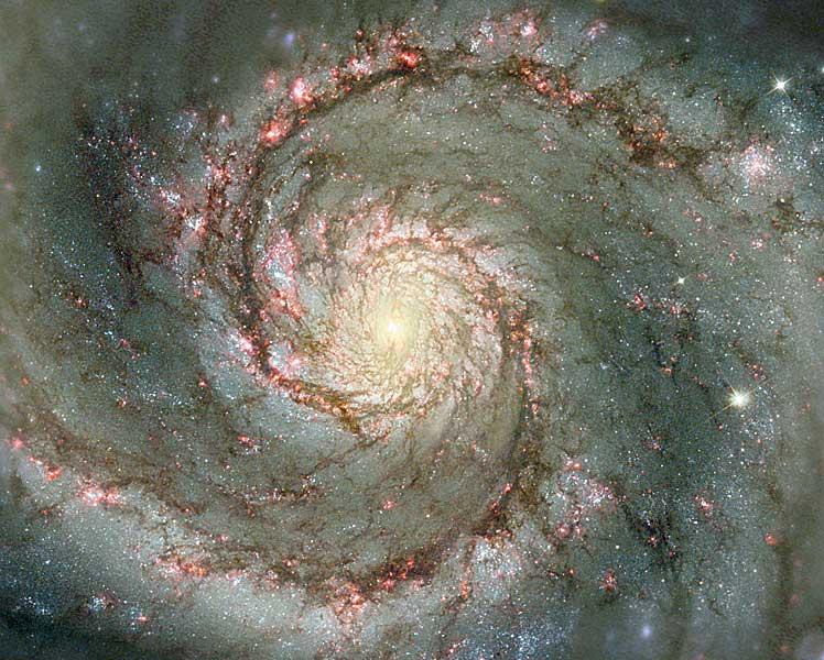 M51: La Galaxia Remolino en polvo y estrellas