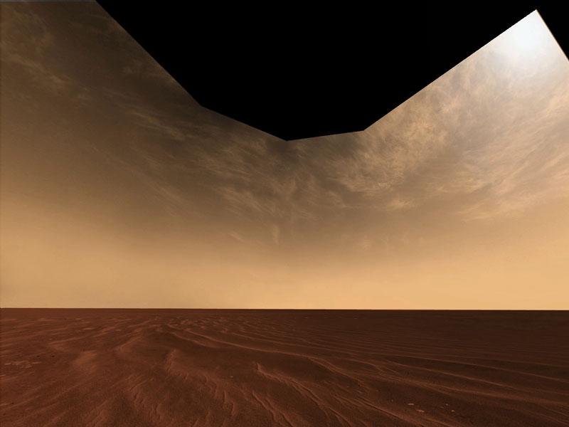Nubes y Arena sobre el Horizonte de Marte