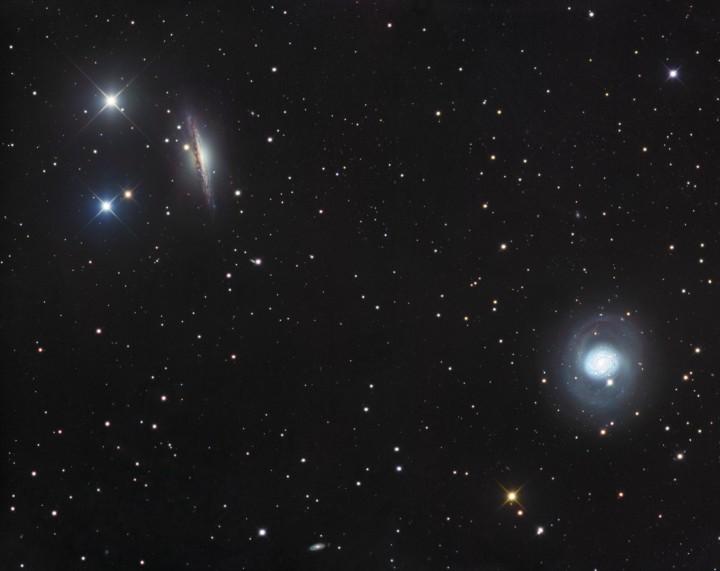 NGC 1055 a M77