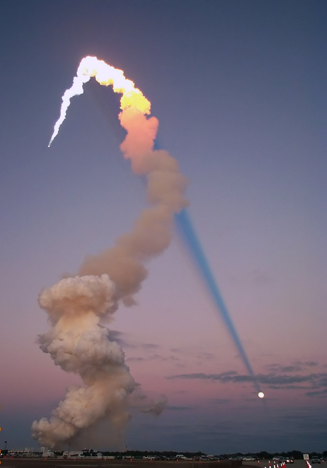 APOD: 2007 June 3 - Shuttle Plume Shadow Points to Moon