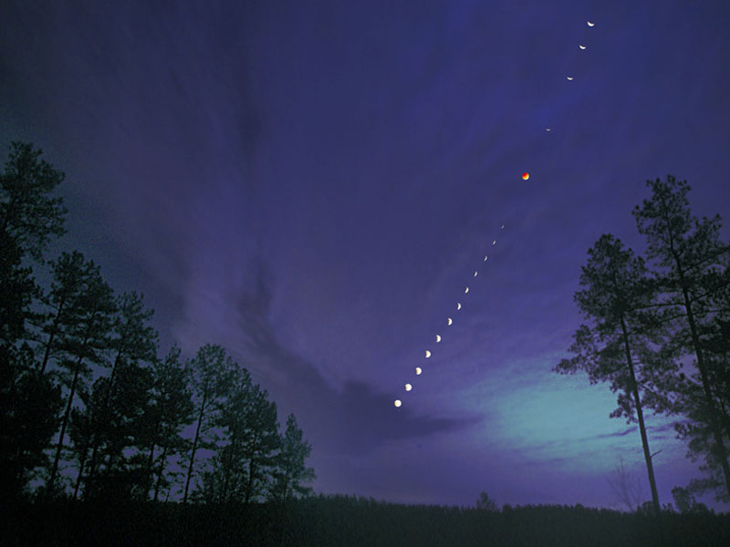 A total lunar eclipse shown in a time lapse image captured in 2003 over North Carolina, USA