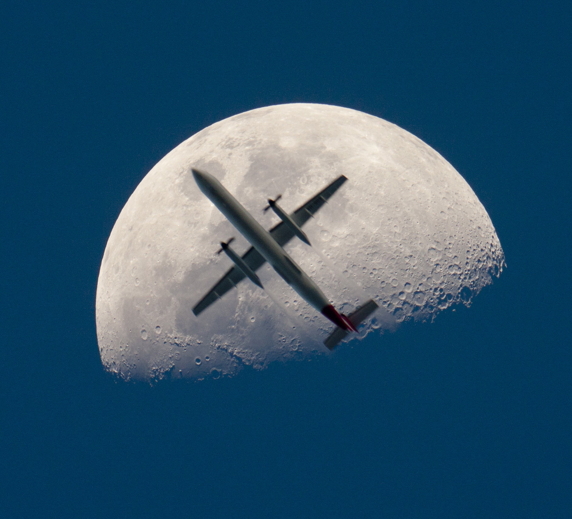 An Airplane in Front of the Moon. Credit & Copyright to Chris Thomas via APOD