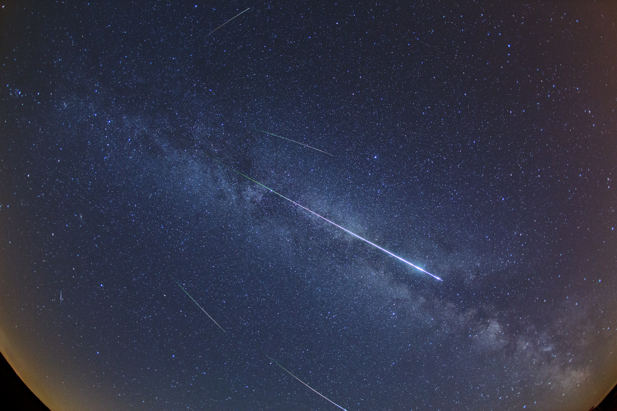 APOD: 2012 August 14 - Perseid Meteors and the Milky Way