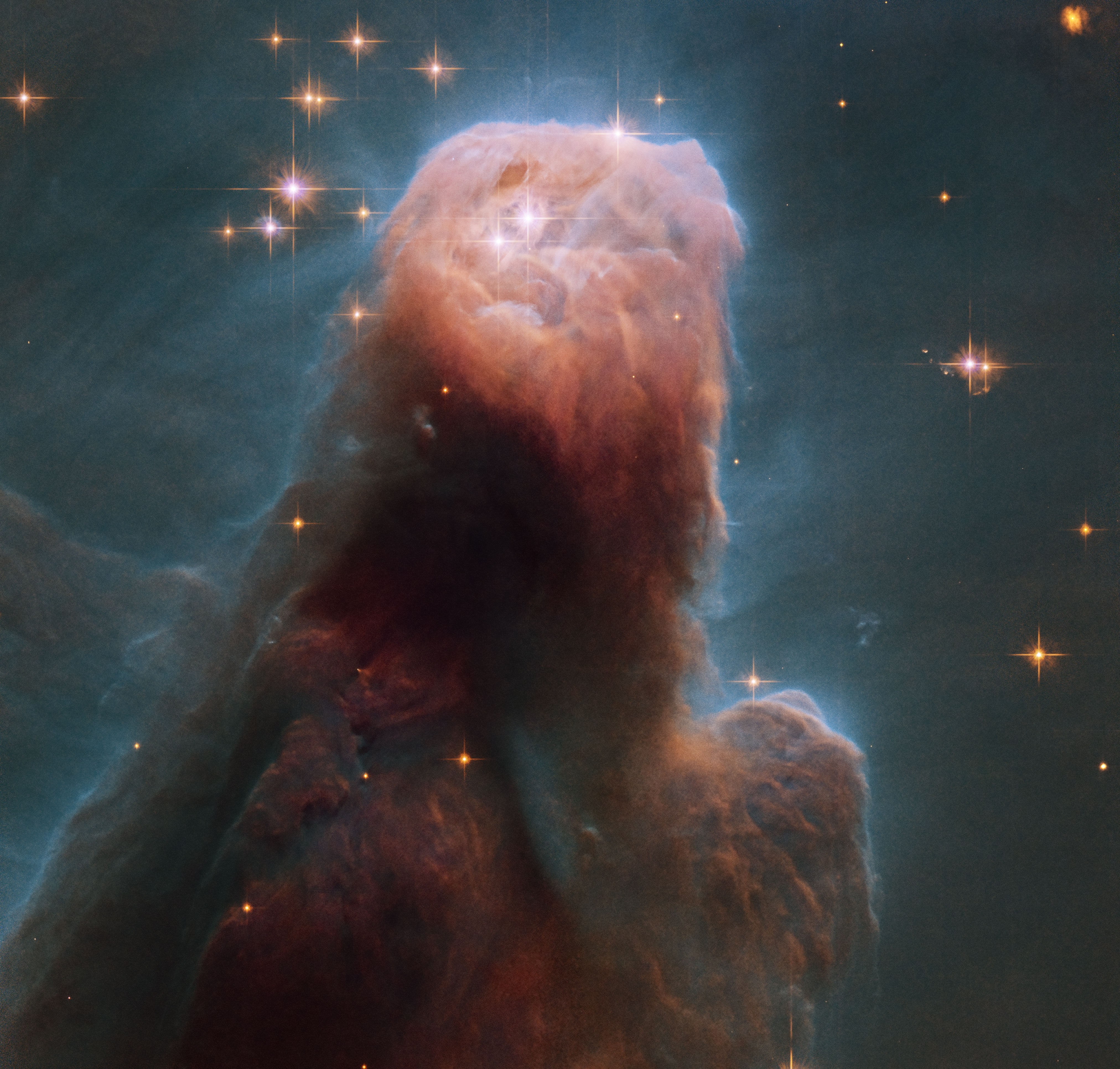 Across The Universe: The Cone Nebula from Hubble