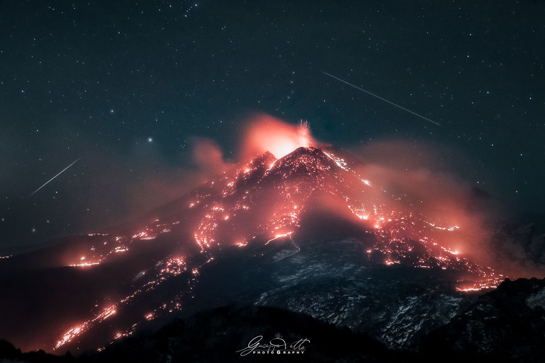 Stars over an Erupting Volcano