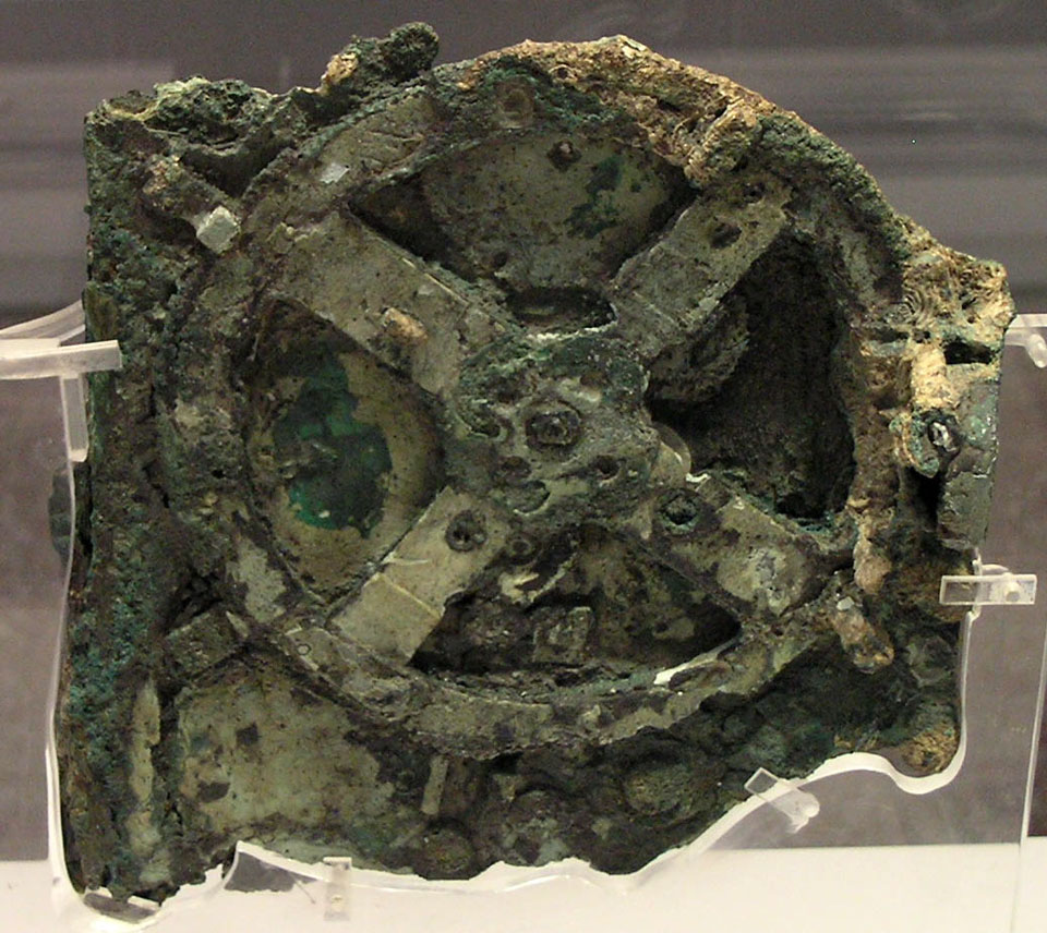 The ancient Antikythera mechanism is shown, the oldest known orrery. See Explanation.