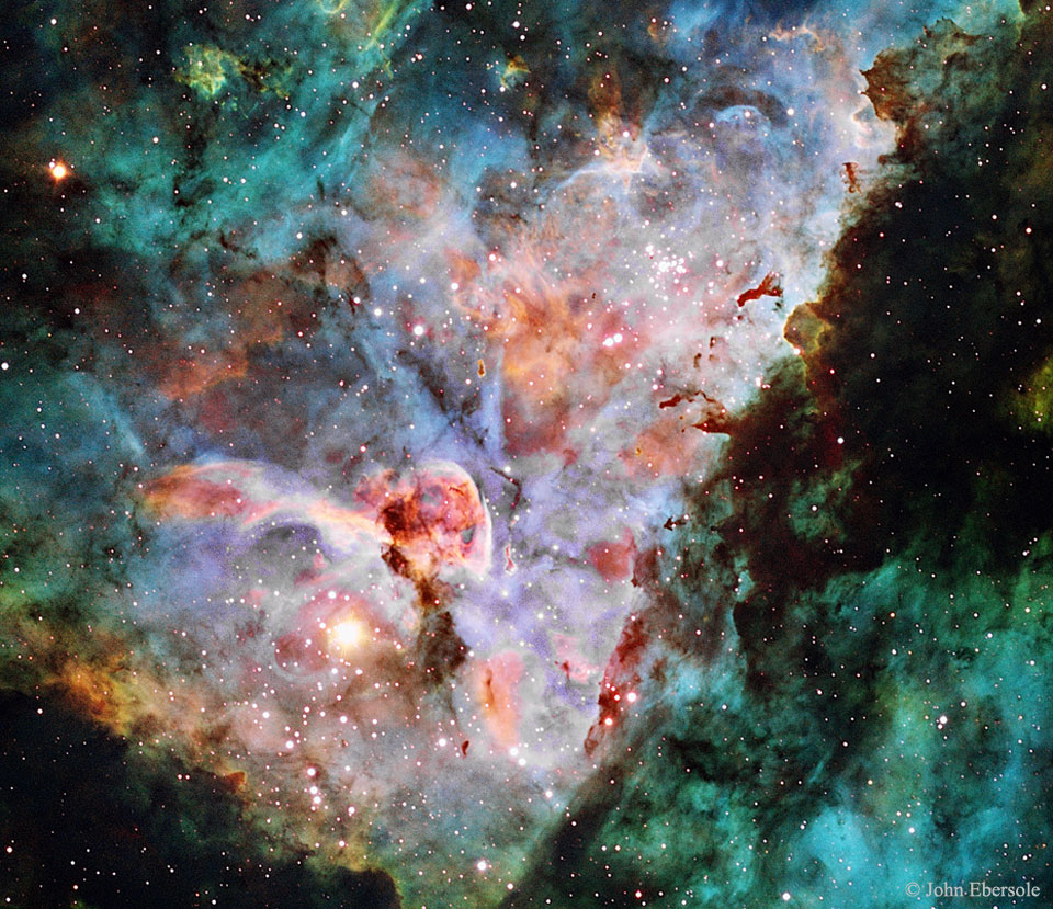 A picture of the gas and dust clouds that appear in the center of the Carina Nebula.  Please see the explanation for more detailed information.