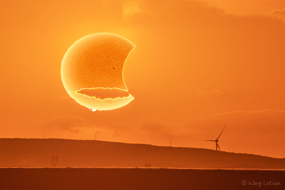 The picture shows an artistic photograph of a partial solar eclipse. Please see the explanation for more detailed information.