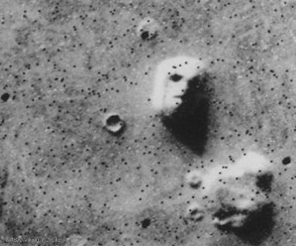 The picture shows a Martian rock formation nicknamed the Face on Mars. Please see the explanation for more detailed information.