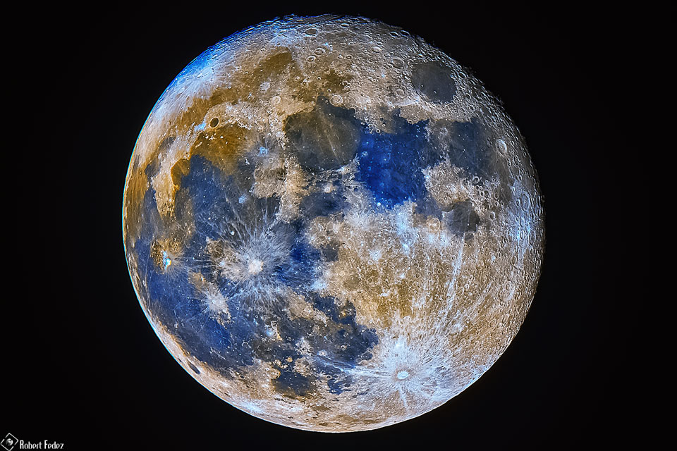 The picture shows the full moon in high resolution and exaggerated colors. Please see the explanation for more detailed information.