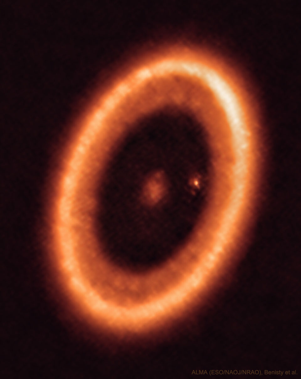 The picture shows planet forming star system PDS 70.  A planet forming ring is visible as well as a planet still forming a moon. Please see the explanation for more detailed information.