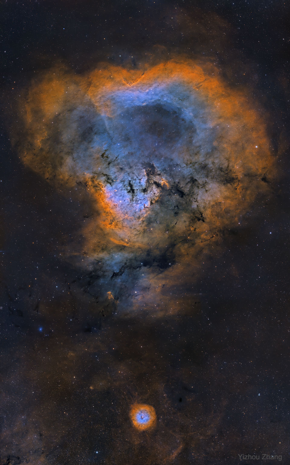 The picture shows a NGC 7822, known informally as  the Cosmic Question Mark Nebula.  Please see the explanation for more detailed information.
