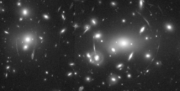 Abell 2218: Un cúmulo de galaxias y una lente
