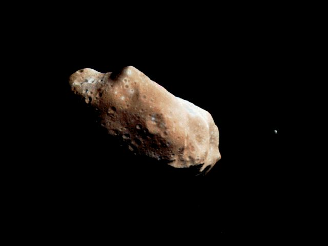 APOD: August 7, 1999 - Ida and Dactyl: Asteroid and Moon