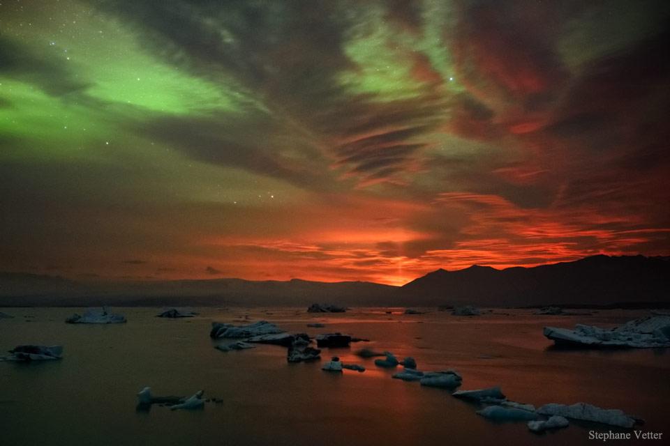 Aurora and Volcanic Light Pillar   -  That