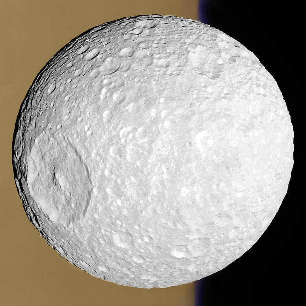 Mimas: Small Moon with a Big Crater  -  Whatever hit Mimas nearly destroyed it.