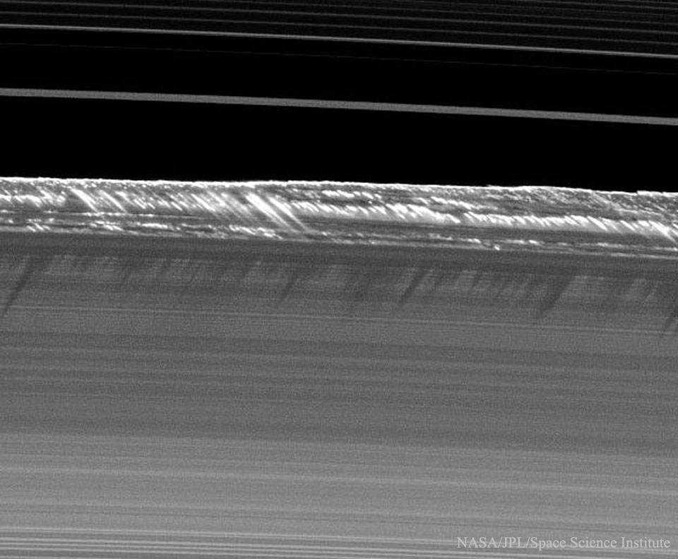 Propeller Shadows on Saturns Rings  -  What created these unusually long shadows on Saturn