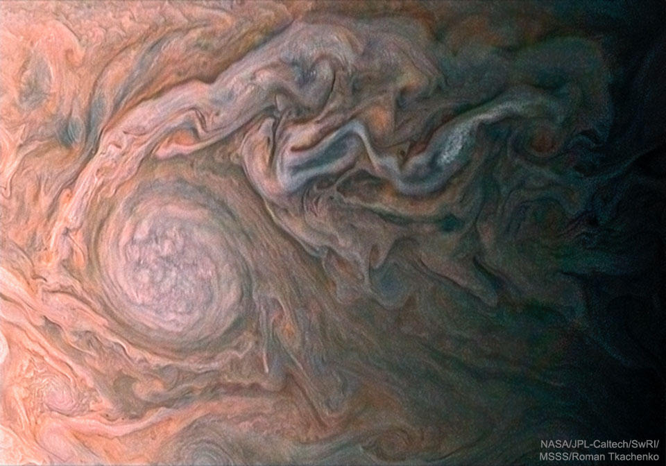 A White Oval Cloud on Jupiter from Juno  -  This storm cloud on Jupiter is almost as large as the Earth.