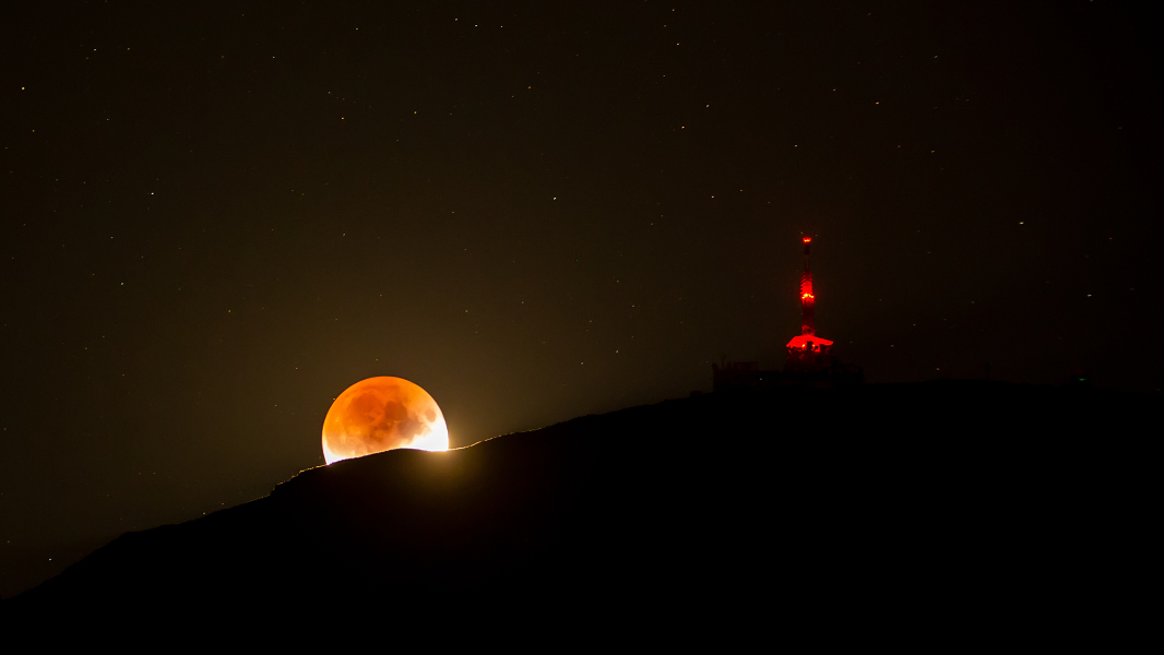 Shadowed Moon and Mountain -  On July 16 the Moon celebrated the 50th anniversary of the