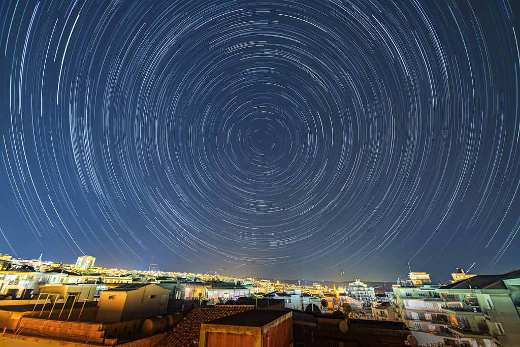 Stars Trail over Ragusa -  In trying times, stars still