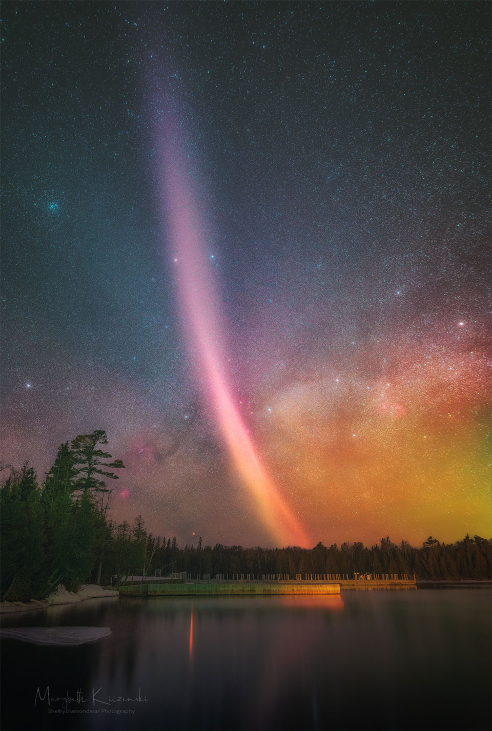 A picture of a STEVE arc over Copper Harbor, Michigan, with the Milky Way across the background.  Please see the explanation for more detailed information.